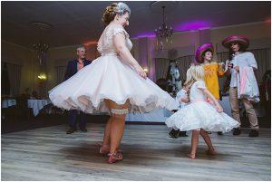 Bride spinning showing garter Letchworth wedding photographer sharon cooper